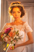Young bride in wedding dress — Stock Photo