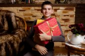 Portrait of adorable boy with giftboxes — Stock Photo