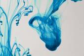 Blue and violet liquid in water making abstract forms — Stock Photo