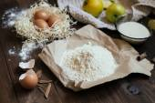 Charlotte cake ingredients on wood table — Stock Photo