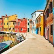 Colorful houses by the water canal at the island Burano near venice, Italy — Stock Photo #54985955