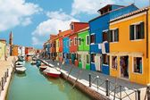 Colorful houses by the water canal at the island Burano near venice, Italy  — Stock Photo