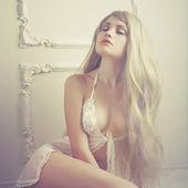 Sensual lady in classical interior — Stock Photo