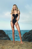 Lady in black swimsuit on seashore — Foto Stock