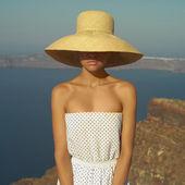 Pretty woman in straw hat — Stock Photo