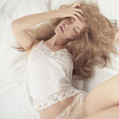 Sexual woman in bed — Stock Photo