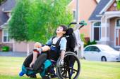 Disabled boy enjoying time at the park — Stock Photo