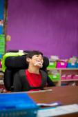 Disabled boy in first grade classroom — Stock Photo