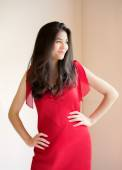 Beautiful biracial teen girl in elegant red dress — Stock fotografie