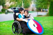 Disabled brother hugging sister in park — Stock Photo