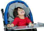 Three year old biracial disabled boy in medical stroller, happy  — Stock Photo