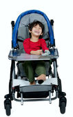Three year old biracial disabled boy in medical stroller, happy  — Stock fotografie