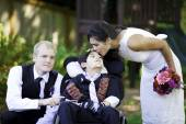 Biracial bride kissing her little brother on her wedding day. Ch — Foto de Stock