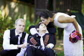 Biracial bride kissing her little brother on her wedding day. Ch — Stock Photo