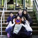 Interracial family surrounding disabled boy in wheelchair outdoo — Stok fotoğraf #68971443