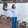 Young teen girl with arms lifted and outstretched, praising God — Stock Photo #72431125