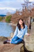 Happy young teen girl face upturned, smiling, while sitting outd — Stock Photo