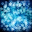 Blue abstract background with bokeh defocused lights. — Stock Vector #52280313