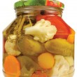 Pickled canned vegetables homemade assortment, isolated glass jar, large detailed macro closeup studio shot, tomatoes, cucumbers, carrots, cauliflowers, dill, garlic peppers — Stock Photo #54005989
