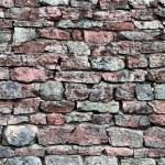Stone wall closeup, horizontal stonewall pattern background, old aged weathered red grey grunge limestone dolomite calcium carbonate hard sedimentary slate slab rock texture, natural grungy textured bricks, beige, yellow, reddish, gray brick vintage — Stock Photo #79526936