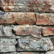 Stone wall macro closeup, stonewall pattern background, vertical, old aged weathered red and grey grunge limestone dolomite calcium carbonate hard sedimentary slate slab rock texture, natural grungy textured bricks, beige, yellow, reddish, gray brick — Stock Photo #82279174