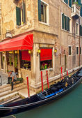 Narrow canal with boat — Stock Photo
