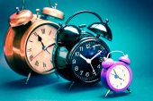 Three alarm clocks — Stockfoto