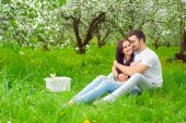 Young couple in the garden — Stock Photo