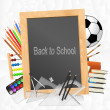 School supplies with blackboard on crumpled paper background — Stok Vektör #55098161