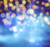 Blue Festive Christmas background. Abstract background with bokeh defocused lights and stars — Foto de Stock