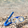Diving mask glasses and pipe at summer beach — Stock Photo #69820579