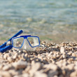 Diving mask glasses and pipe at summer beach — Stock Photo #69821335