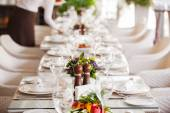 Table setting in restaurant interior, desaturated — Stock Photo