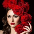Beautiful Fashion Model Girl Portrait with big Red Roses in hair — Stock Photo #72784103