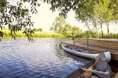 Canoes by the river — Stock Photo