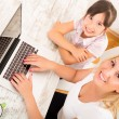 Mother and Daughter with a Laptop at home — Stockfoto #60356041