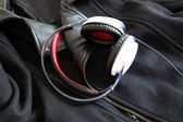 Headphones on a black Jacket  — Stock Photo