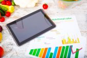 Healthy nutrition and tablet — Stock Photo