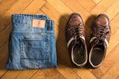 Shoes and jeans on the floor — Stock Photo