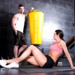 Young couple taking a break in a Gym during workout — Stock Photo #70663677