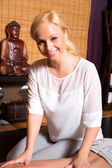 A young beautiful masseuse applying a massage — Stock Photo