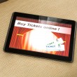 Buy Cinema Tickets online with a Tablet PC — Stock Photo #72634753
