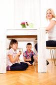 Kids eating chocolate at home — Stockfoto