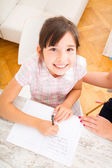 Mother helping her daughter with the homework — Stock Photo