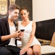 A young couple enjoying a glass of wine in a asian style hotel r — Stock Photo #76551989
