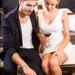 A young couple enjoying a glass of wine in a asian style hotel r — Stock Photo #76552035