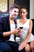 A young couple enjoying a glass of wine in a asian style hotel r — Stock Photo