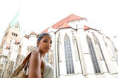 Young woman at the cathedral — Stok fotoğraf