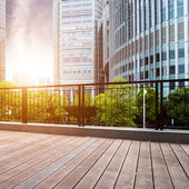 Office buildings and wooden platforms — Stock Photo