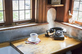 Antique Phone and Cup of Coffee in Old Kitchen Setting — Stock Photo